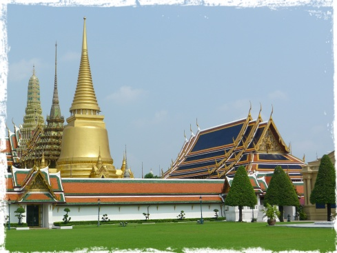 This shot of the stupas of Wat Prakeaw was taken while I walked through Sanam Luang (The Royal Field).