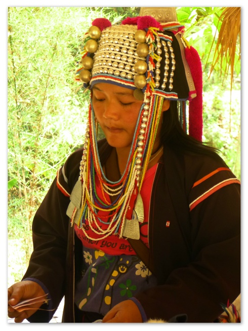 An Akha selling hand-crafted souvenirs.