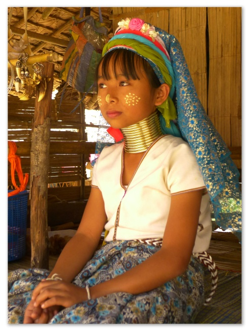 The origins of the metal coil around the Padaung tribes' necks are more for protection than for aesthetics. When tigers attack, they usually go for the neck area, so to protect pregnant women and children who could not climb trees as fast as the rest, they wore these metal coils to protect themselves.
